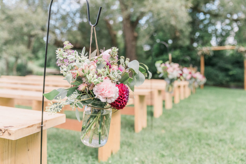 White burgundy blush green aisle markers