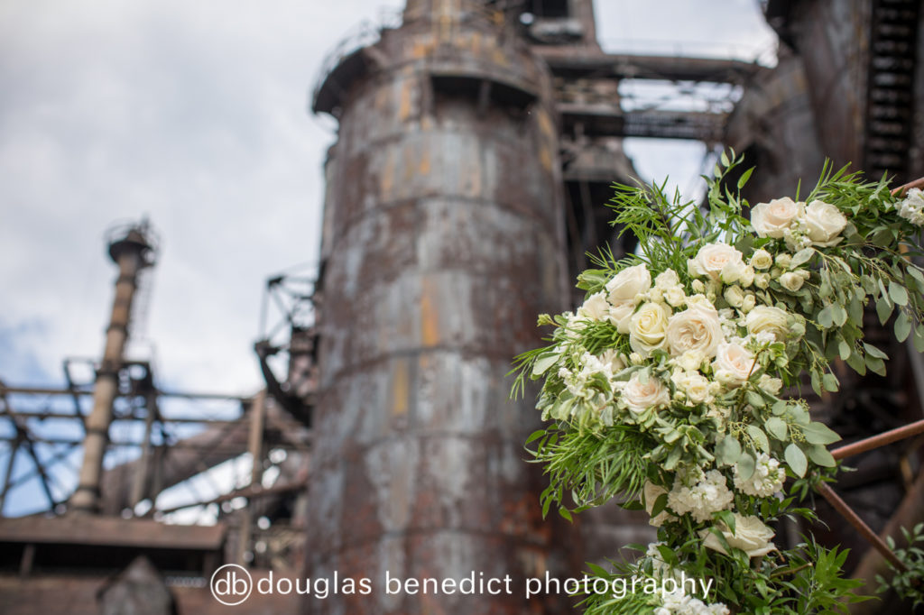 industrial background ceremony and white florals