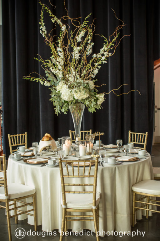 white and green sticks and orchid high centerpieces