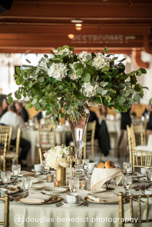 white and green lush high centerpiece