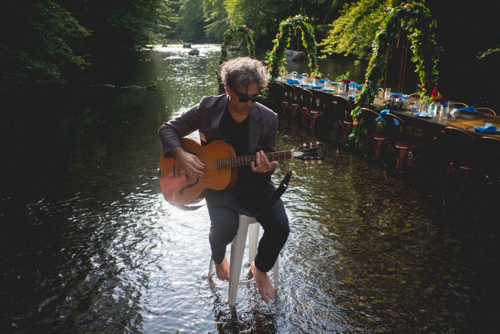 dinner in a creek guitarist