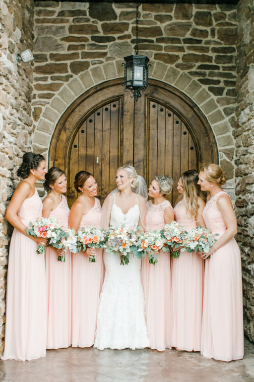 blush pink, coral, sage green, winery wedding bride and bridesmaids