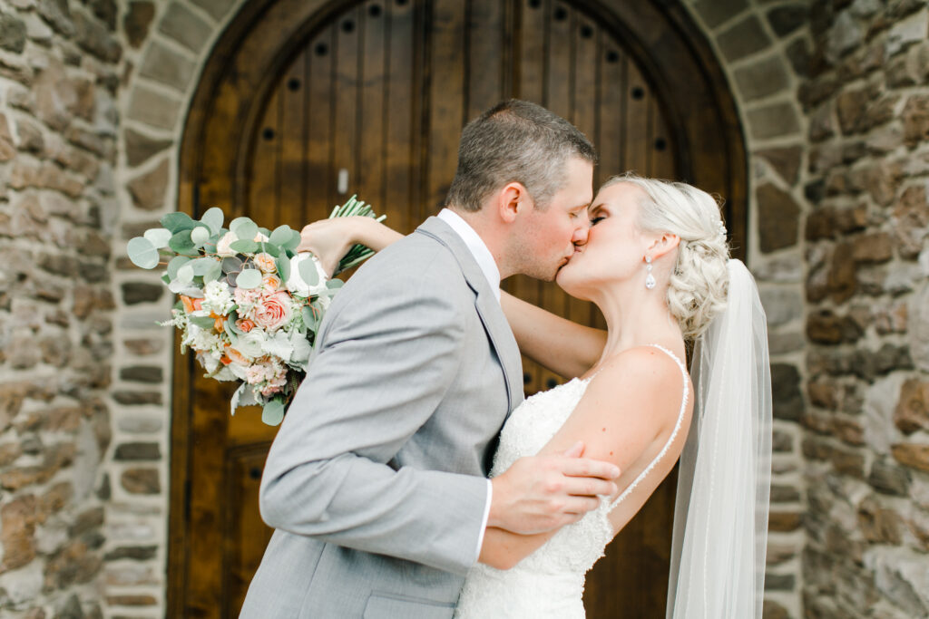 blush pink, coral, sage green, winery wedding bride and groom