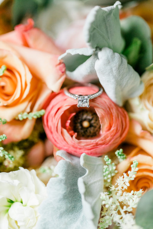 blush pink, coral, sage green, winery wedding rinunculus and ring