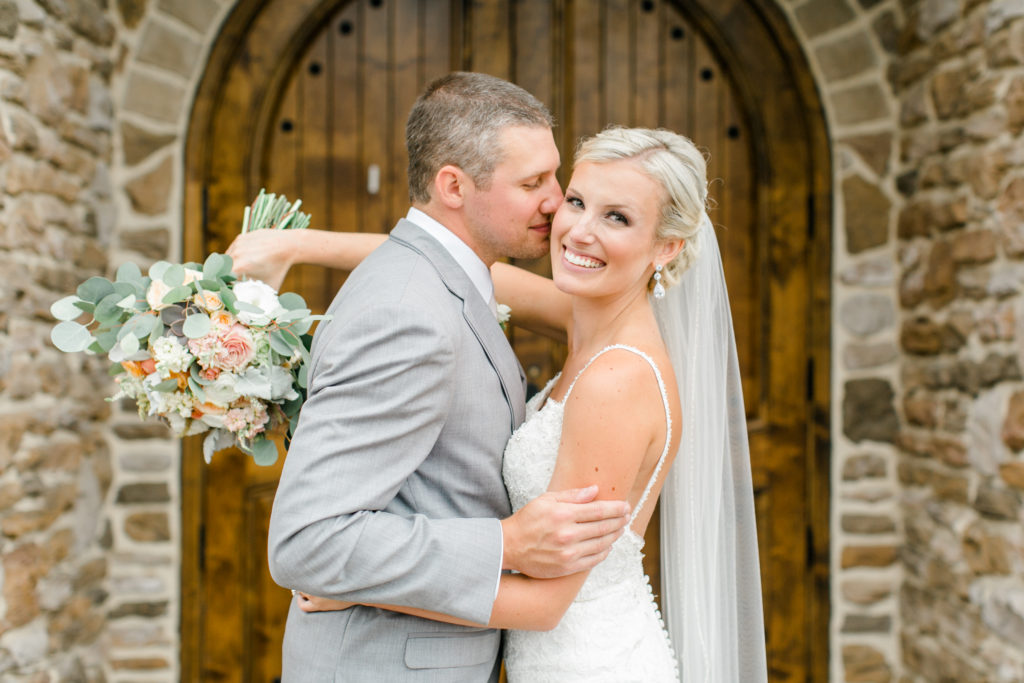 blush pink, coral, peach, sage, winery wedding bride and groom