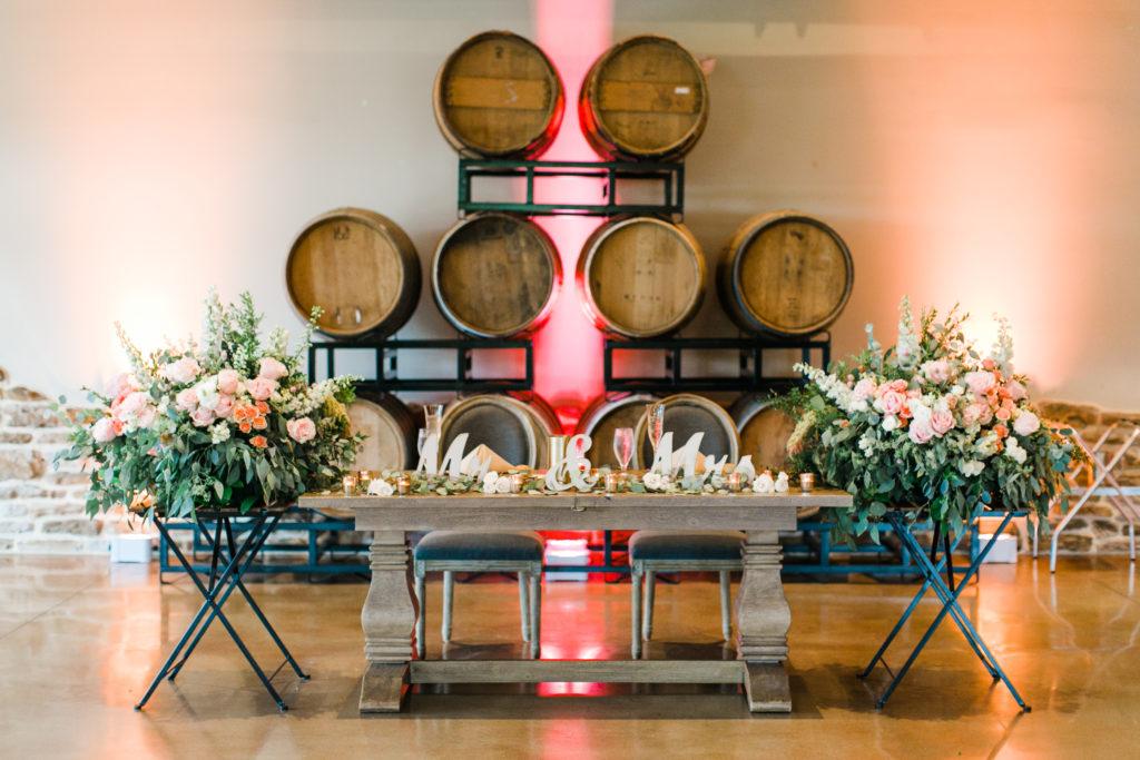 blush pink, coral, sage green, winery wedding wine barrel backdrop sweetheart table