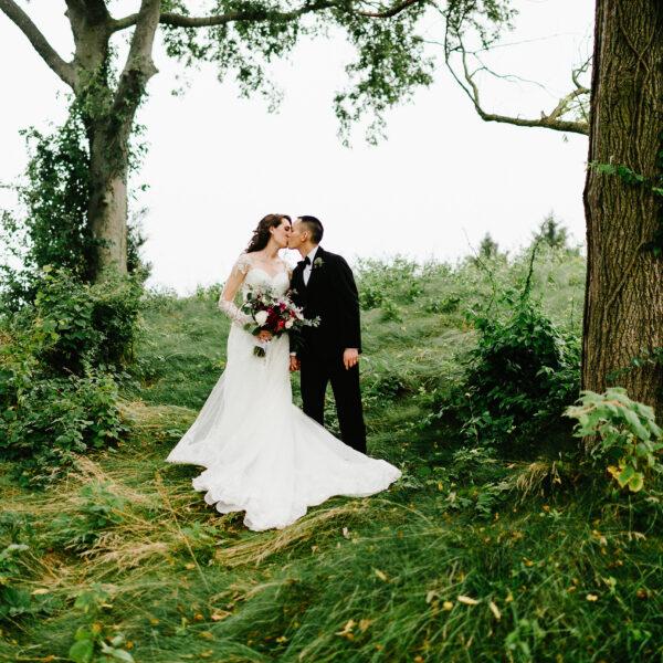 red, purple, lush greenery, stylish, wedding, lush greenery forest, bride and groom