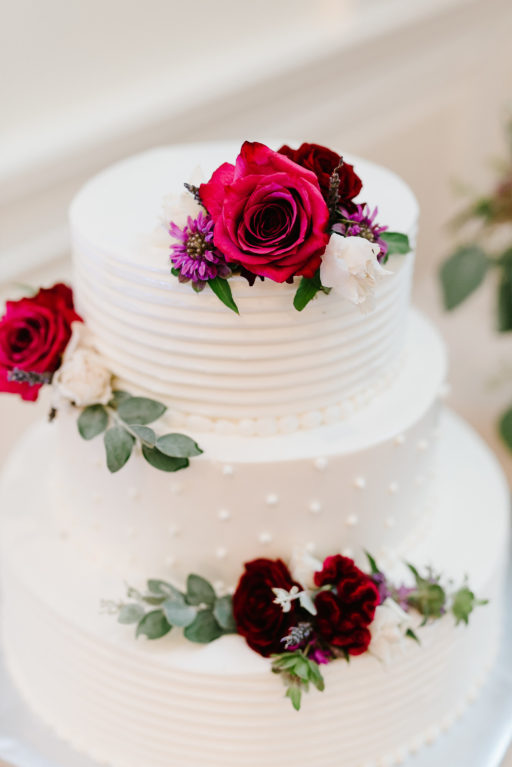 red, purple, lush greenery, stylish, wedding, cake