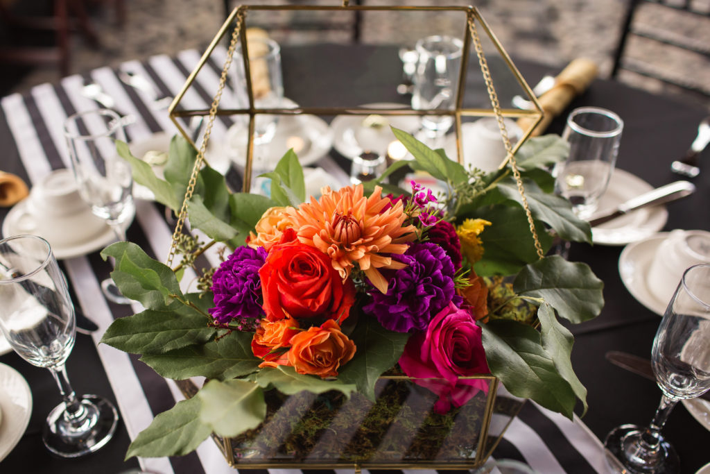 purple, orange, pink, colorful geometric, black and white stripes wedding centerpiece