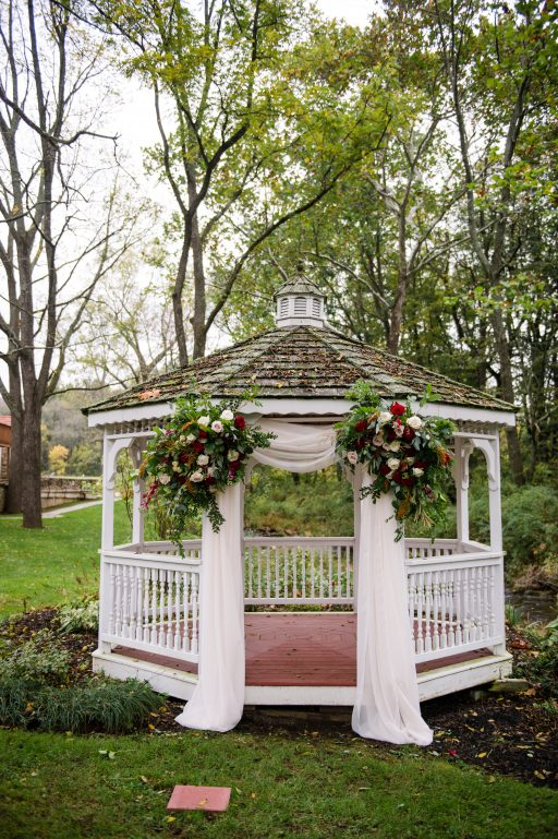 Burgundy, blush, red, greenery, roses, dahlias, rustic chic wedding, gazebo drapery, floral corner pieces