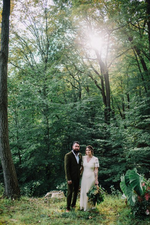 Greenery micro wedding boho palm, hydrangea, ivy, bride and groom