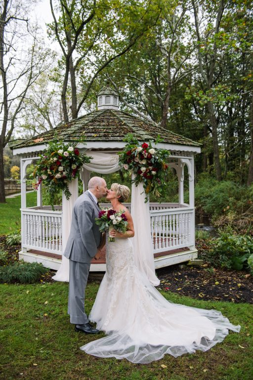 Burgundy, blush, red, greenery, roses, dahlias, rustic chic wedding, gazebo drapery, bride and groom