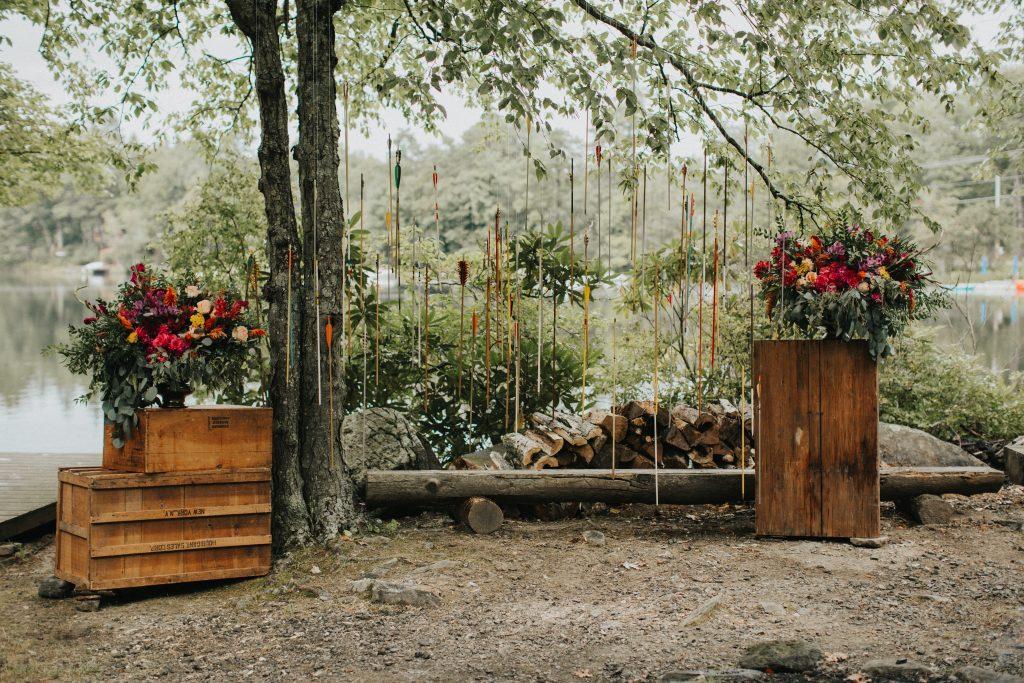 Camp wedding, wild flowers, colors, rustic, arrows ceremony florals