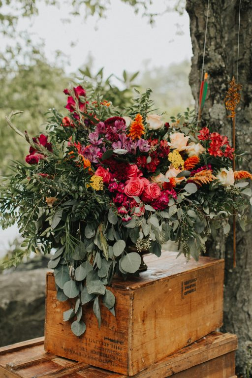 Camp wedding, wild flowers, colors, rustic, arrows ceremony florals