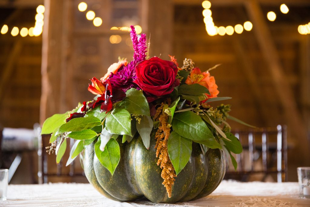 Fall wedding, red, green, yellow, pink florals, dahlias pumpkin centerpiece