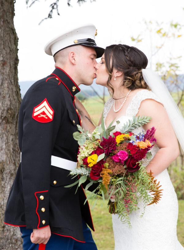 Fall wedding, red, green, yellow, pink florals, dahlias pumpkin bride and groom
