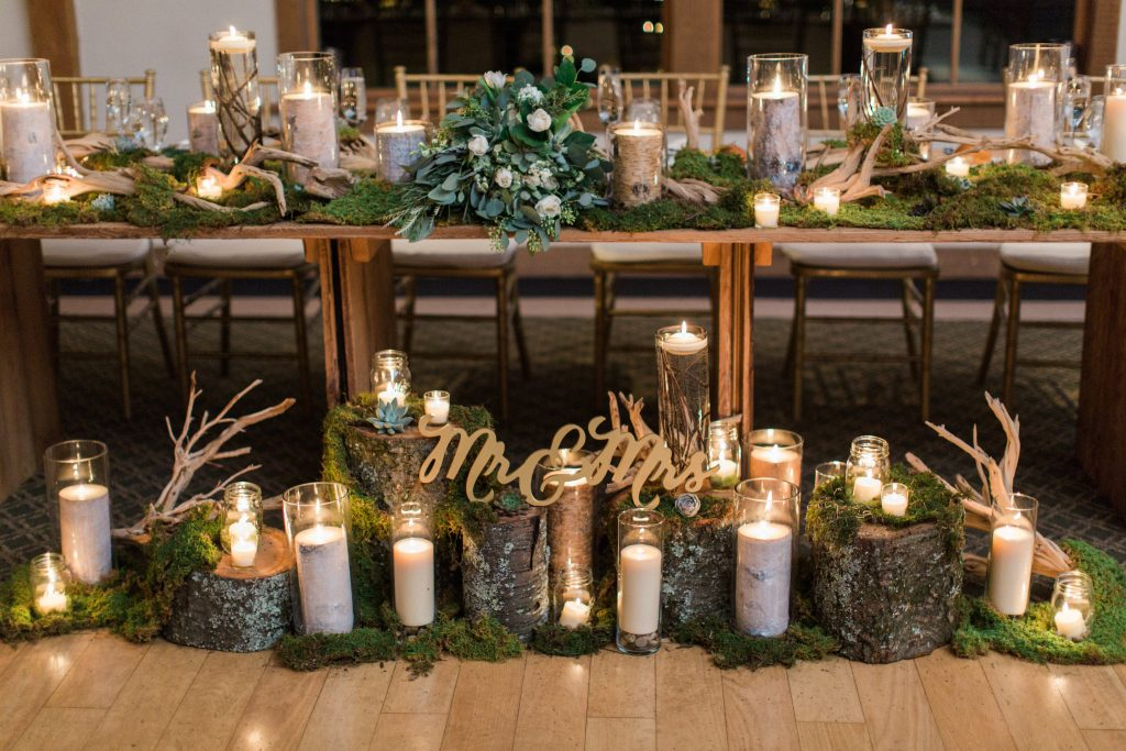 Green, white, cream, blush, eucalyptus, wedding, moss and wood stumps, candles sweatheart table.