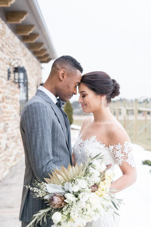 Vineyard, winery, spring shoot, white floral, greenery, tulips, bride and groom