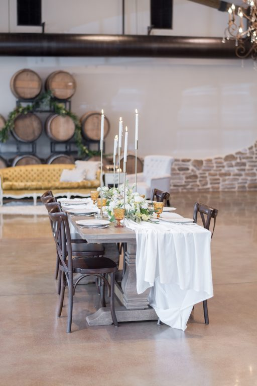 Vineyard, winery, spring shoot, white floral, greenery, tulips, amber glassware, gold candlesticks, centerpiece
