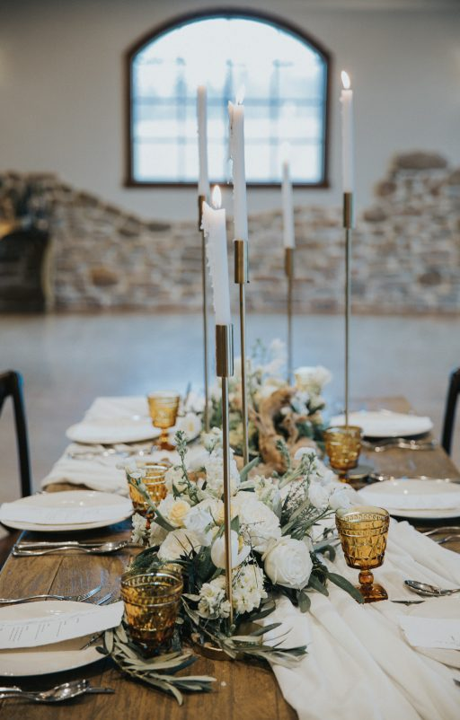 Vineyard, winery, styled shoot, white florals, tulips, greenery. gold candlesticks and amber glassware centerpiece