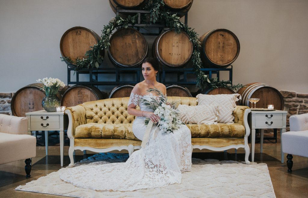 Vineyard, winery, styled shoot, white florals, tulips, greenery. antique couch bridal portrait