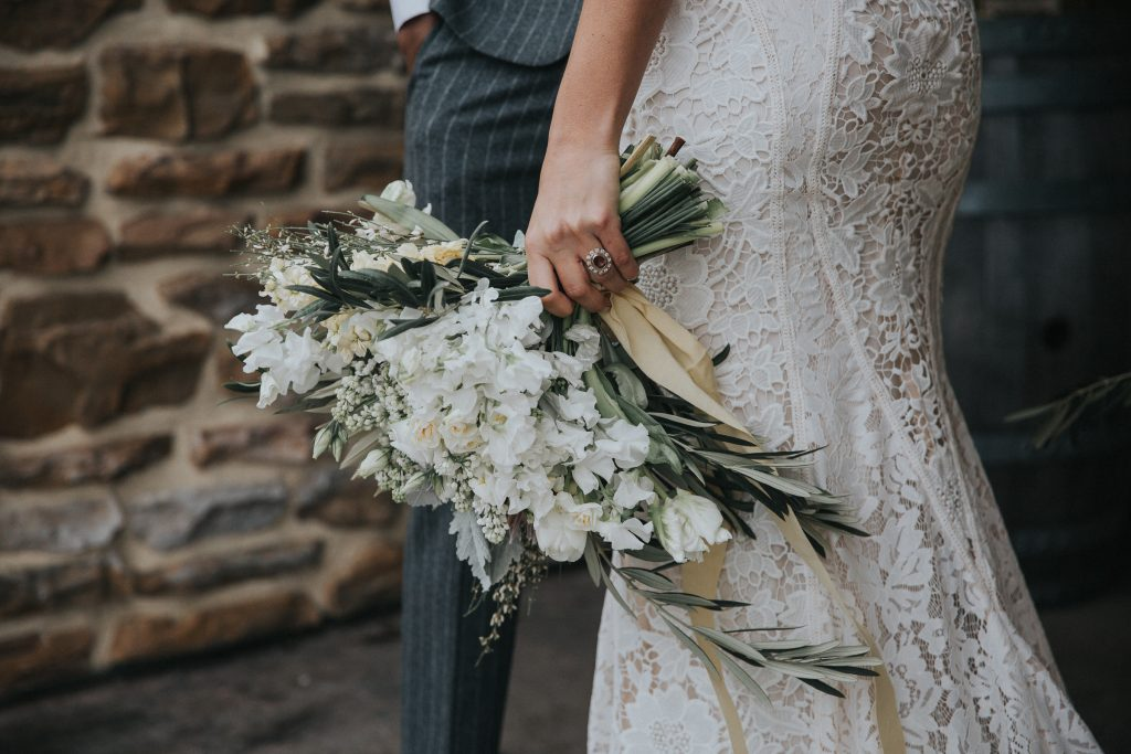 Vineyard, winery, styled shoot, white florals, tulips, greenery. antique couch bride and groom bouquet