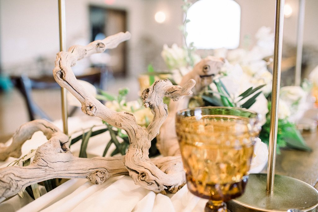 vineyward, winery, styled shoot, spring, white, tulips, greenery, gold candlesticks branches centerpiece