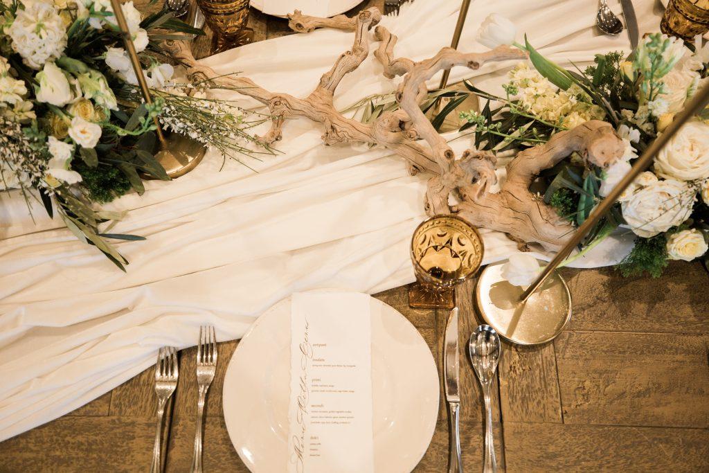Vineyard, winery, spring time, white floral, greenery, tulips, amber, gold candlesticks, sticks