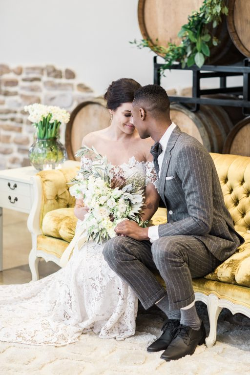 Vineyard, winery, spring time, white floral, greenery, tulips, antique couch, bride and groom