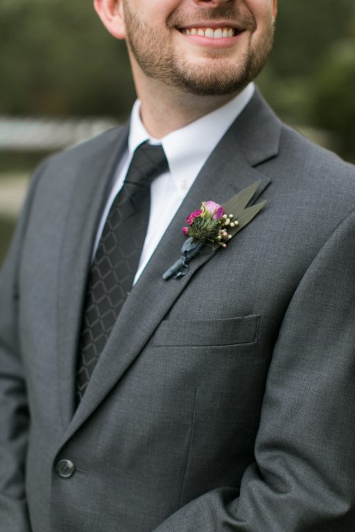 Pink, purple, white, greenery, vibrant wedding, peonies, roses, stock, eucalyptus, organic boutonniere