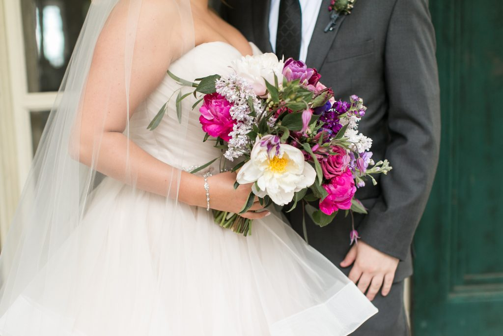 Pink, purple, white, greenery, vibrant wedding, peonies, roses, stock, eucalyptus, organic bouquets bride and groom