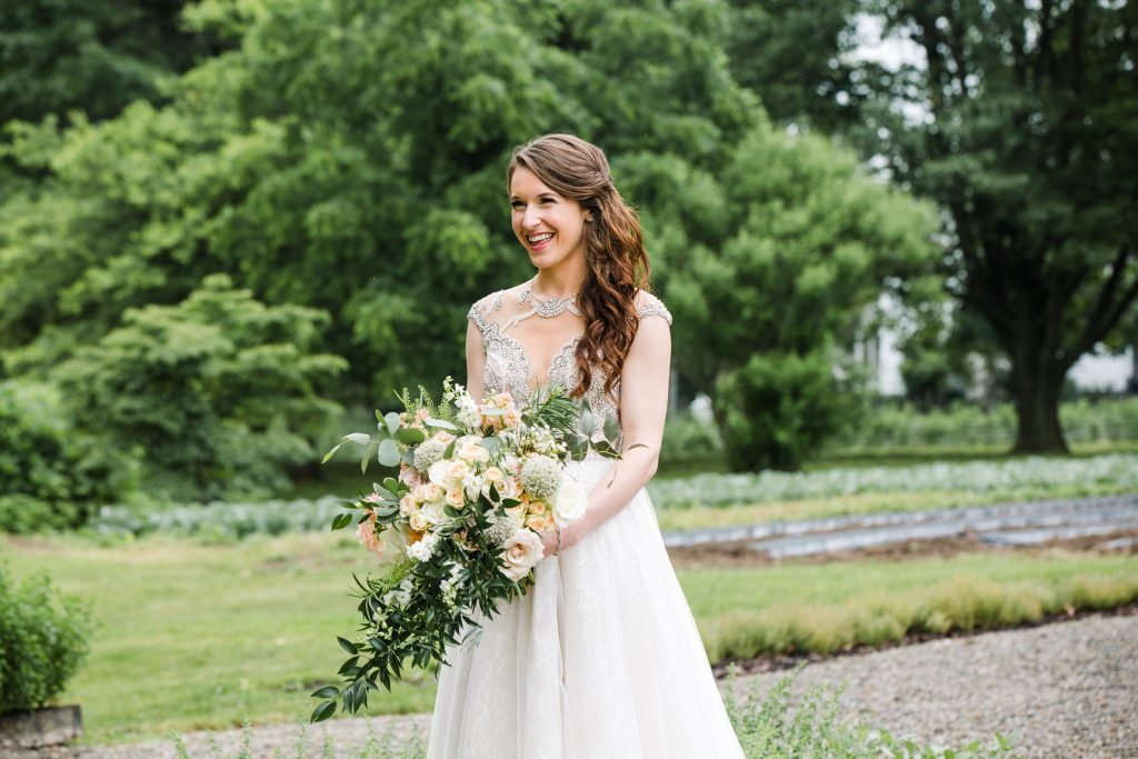 whimsical organic farm wedding, coral, peach, green, blush, roses, tulips, allium, cascade bridal bouquet