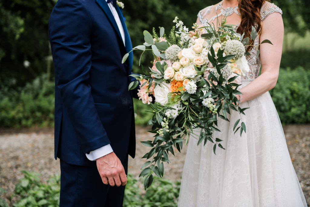 whimsical organic farm wedding, coral, peach, green, blush, roses, tulips, allium, cascade bridal bouquet, first look
