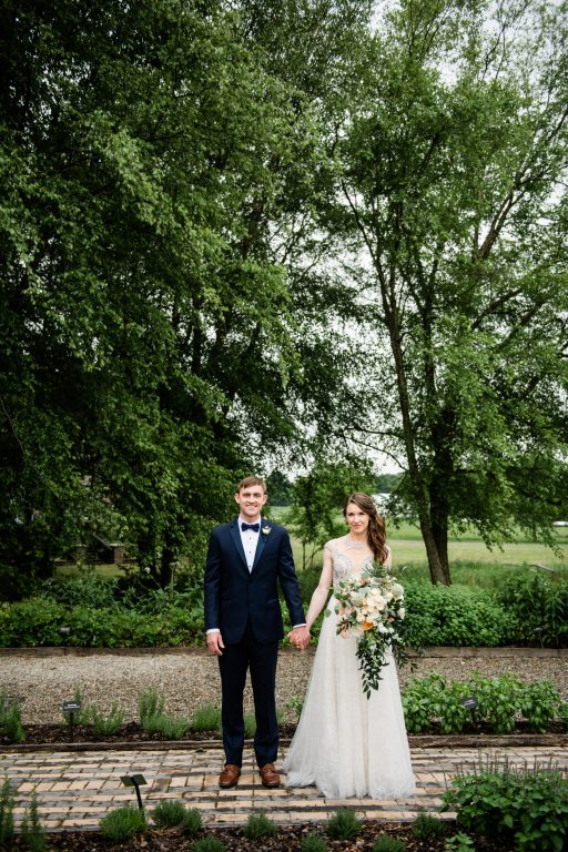 whimsical organic farm wedding, coral, peach, green, blush, roses, tulips, allium, cascade bridal bouquet, first look, bride and groom
