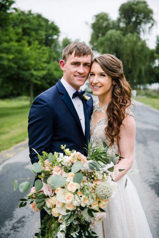 whimsical organic farm wedding, coral, peach, green, blush, roses, tulips, allium, cascade bridal bouquet, greenhouse, bride and groom