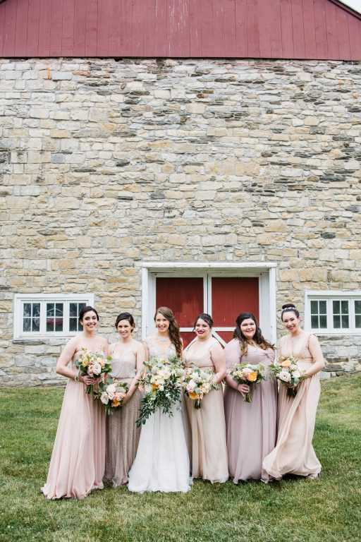 whimsical organic farm wedding, coral, peach, green, blush, roses, tulips, allium, cascade bridal bouquet, bridesmaids