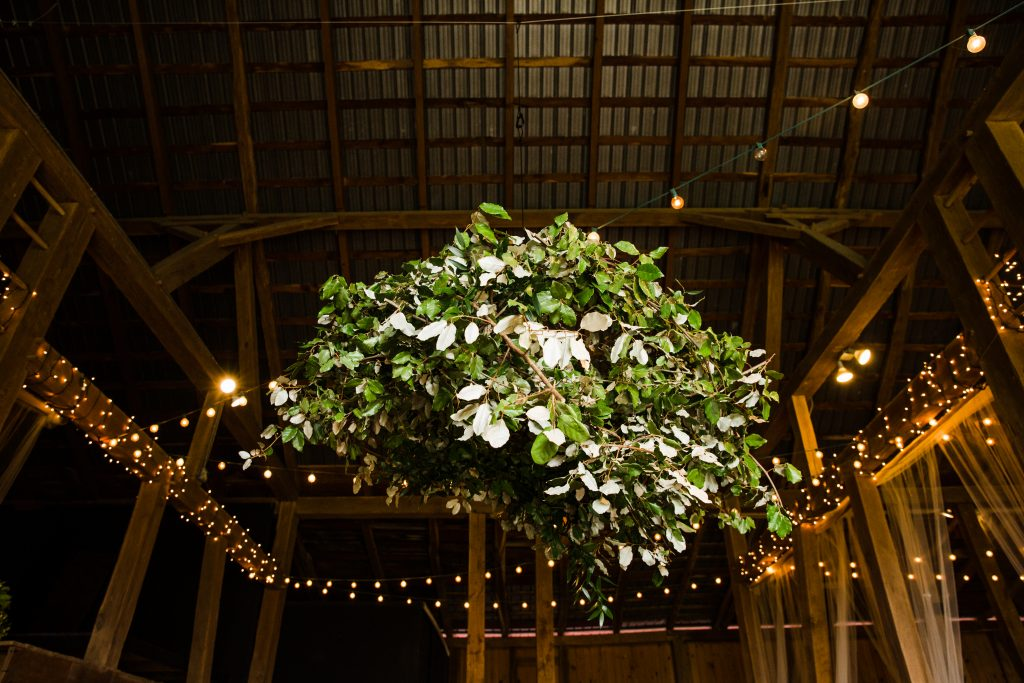 whimsical organic farm wedding, coral, peach, green, blush, roses, tulips, allium, greenery chandelier