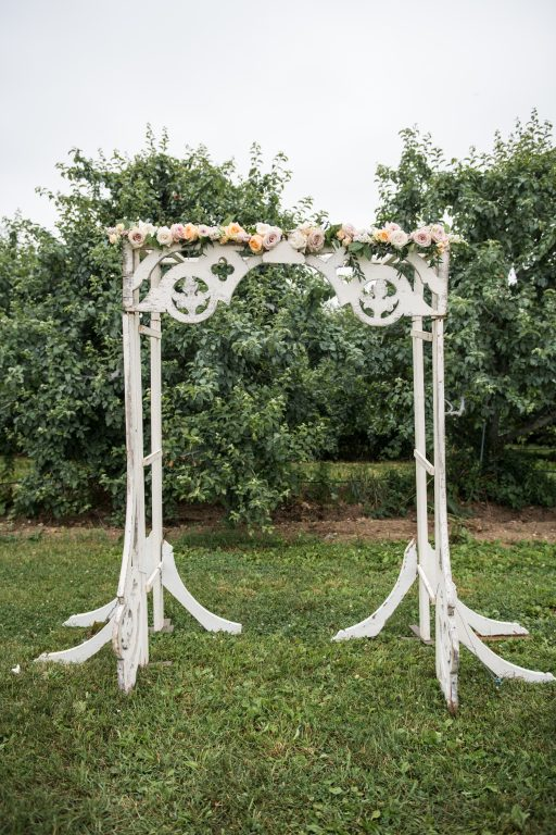 whimsical organic farm wedding, coral, peach, green, blush, roses, tulips, allium, white arbor, florals