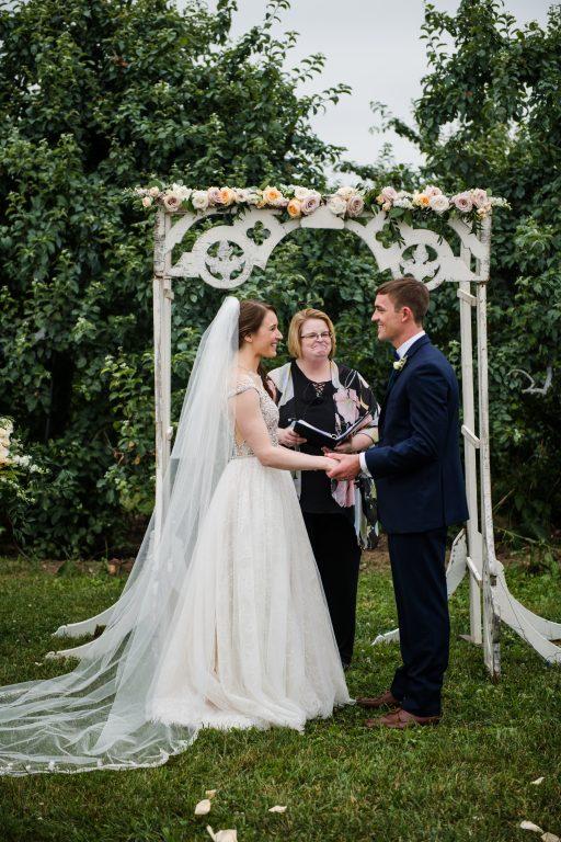 whimsical organic farm wedding, coral, peach, green, blush, roses, tulips, allium, white arbor, florals