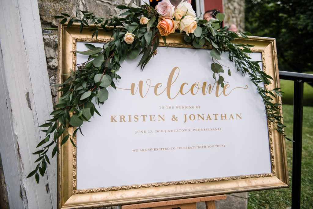 whimsical organic farm wedding, coral, peach, green, blush, roses, tulips, allium, welcome sign, floral swag