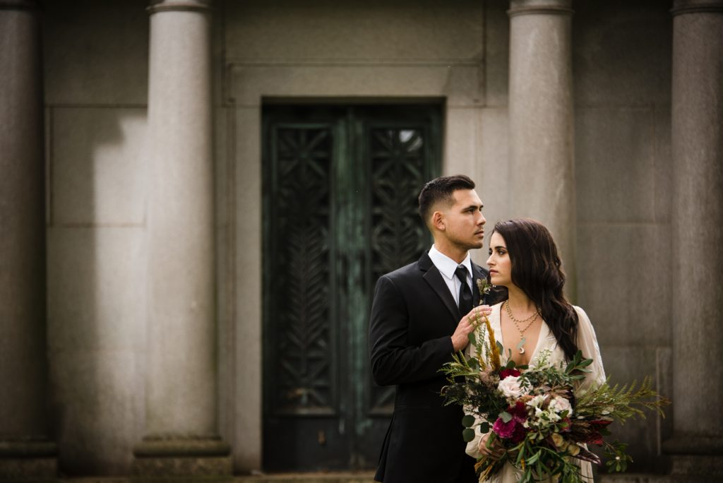 The Originals inspired styled shoot, elopement, microwedding, mysterious, moody, dark color palette, roses, greenery, organic, wild, fall, pinks, purples, yellows, black, bride and groom, cemetary.