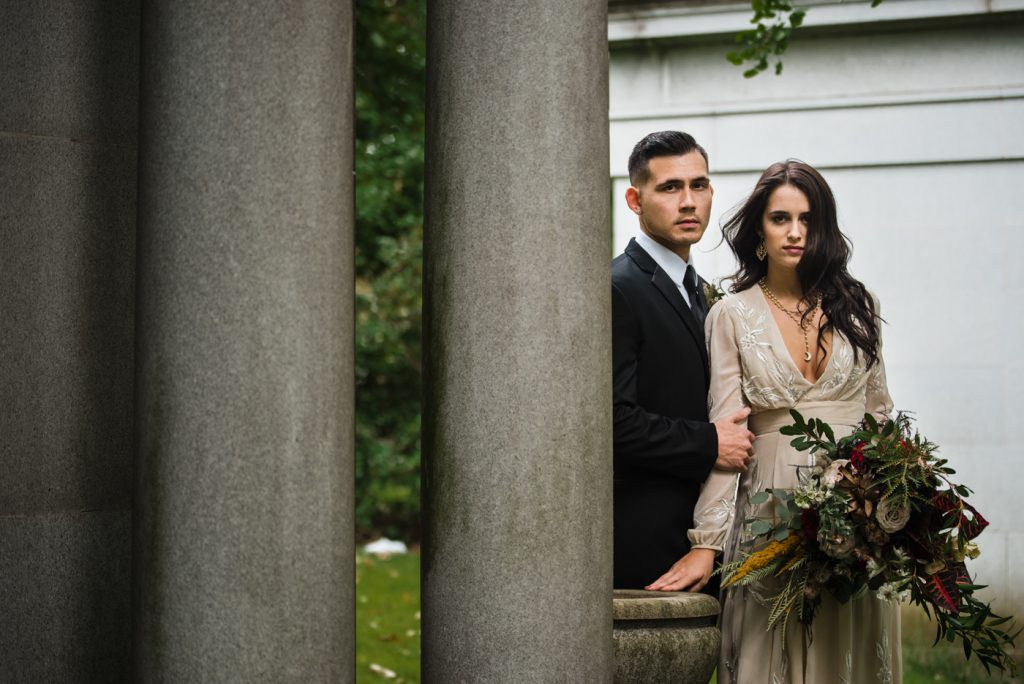 The Originals inspired styled shoot, elopement, microwedding, mysterious, moody, dark color palette, roses, greenery, organic, wild, fall, pinks, purples, yellows, black, bride and groom.