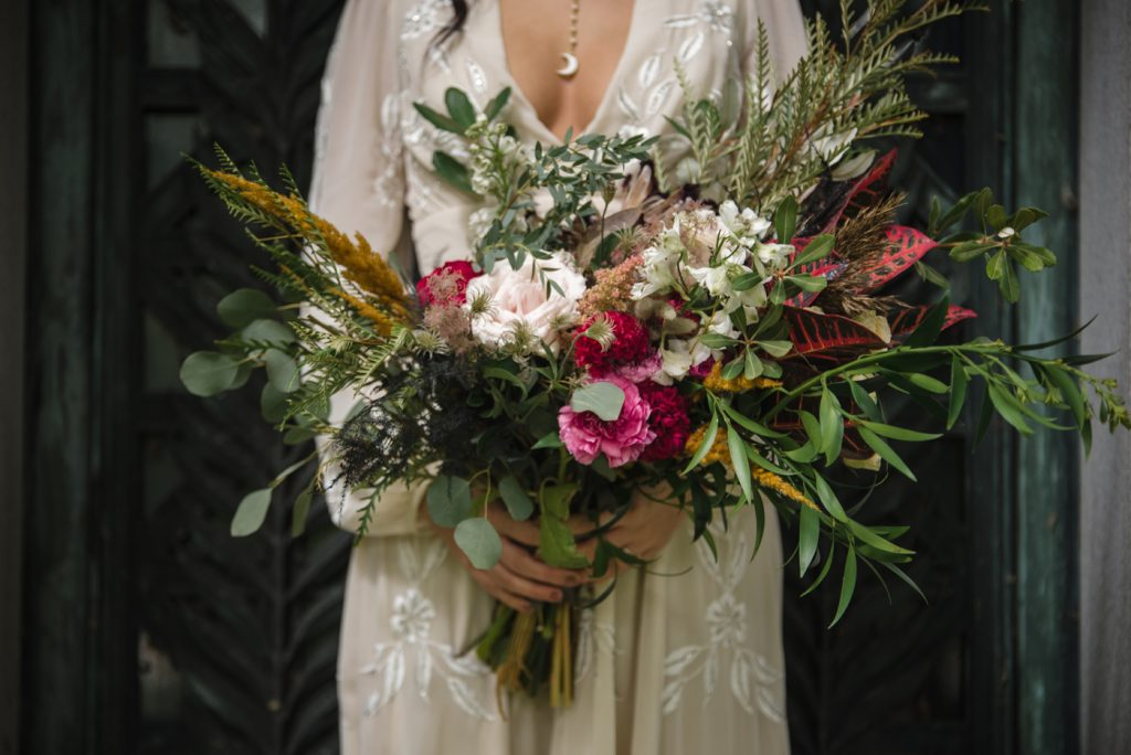 The Originals inspired styled shoot, elopement, microwedding, mysterious, moody, dark color palette, roses, greenery, organic, wild, fall, pinks, purples, yellows, bridal bouquet.