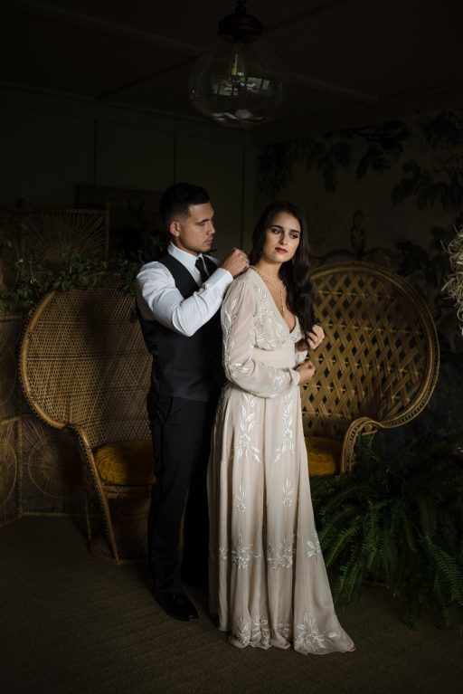 The Originals inspired styled shoot, elopement, microwedding, mysterious, moody, dark color palette, roses, greenery, organic, wild, fall, pinks, purples, yellows, black, bridal, getting ready.