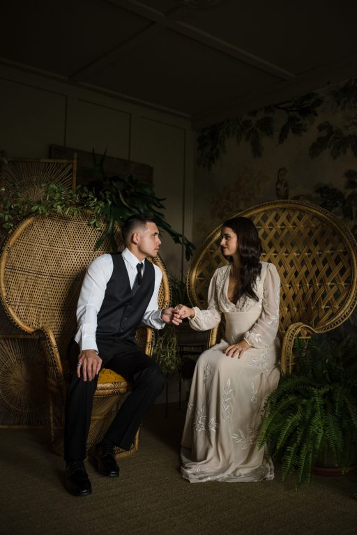 The Originals inspired styled shoot, elopement, microwedding, mysterious, moody, dark color palette, roses, greenery, organic, wild, fall, pinks, purples, yellows, black, bride and groom, getting ready.