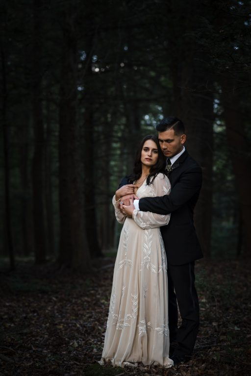 The Originals inspired styled shoot, elopement, microwedding, mysterious, moody, dark color palette, roses, greenery, organic, wild, fall, pinks, purples, yellows, black, bride and groom, forest, dark.