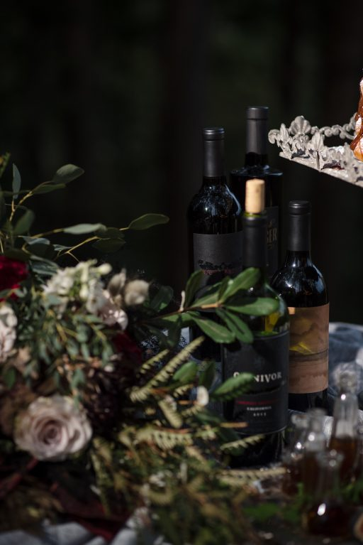 The Originals inspired styled shoot, elopement, microwedding, mysterious, moody, dark color palette, roses, greenery, organic, wild, fall, pinks, purples, yellows, black, wine table.