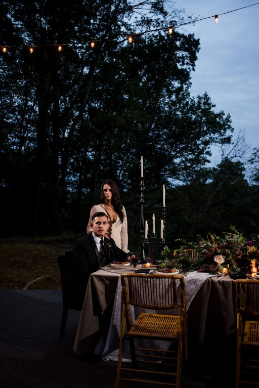 The Originals inspired styled shoot, elopement, microwedding, mysterious, moody, dark color palette, roses, greenery, organic, wild, fall, pinks, purples, yellows, black, dinner.