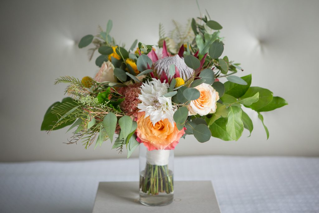 Fall, wedding, secret garden, vintage, viney, blush, peach, muted orange, roses, spray roses, king protea, greenery, birch, dahlias, bridal bouquet.