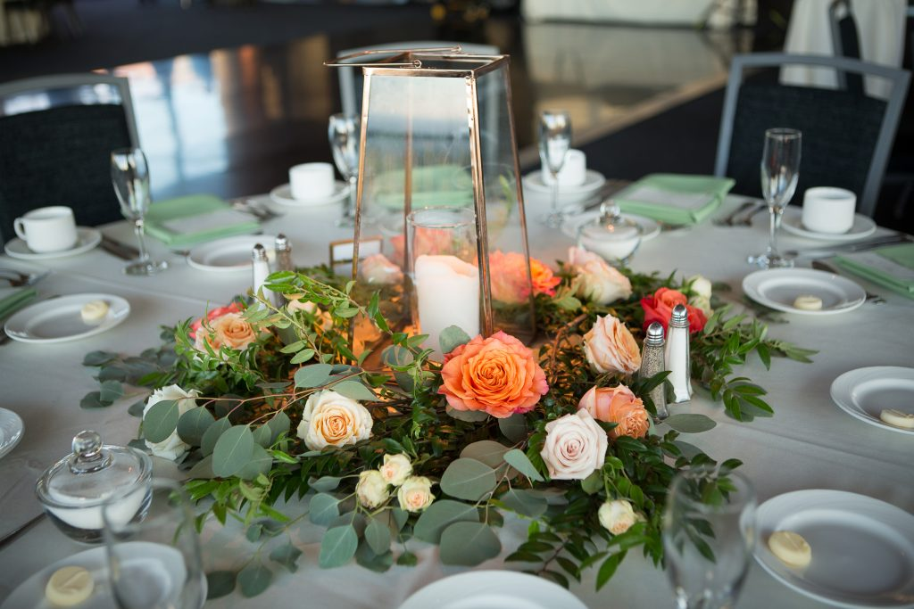 Fall, wedding, secret garden, vintage, viney, blush, peach, muted orange, roses, spray roses, king protea, greenery, birch, dahlias, lantern, greenery, florals, centerpiece.